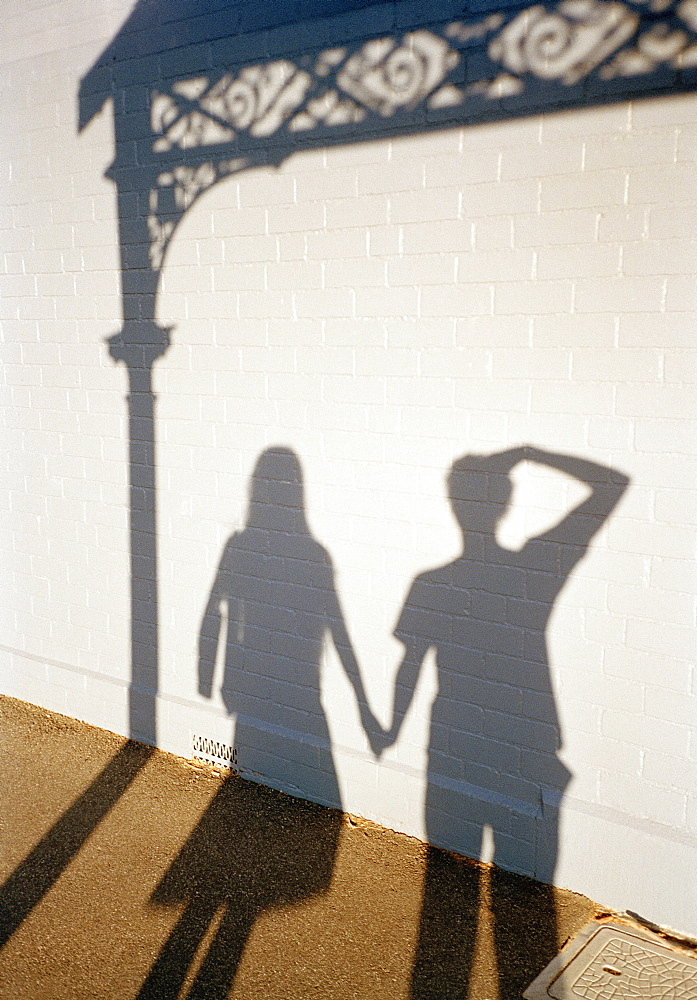 The shadows of a man and a woman