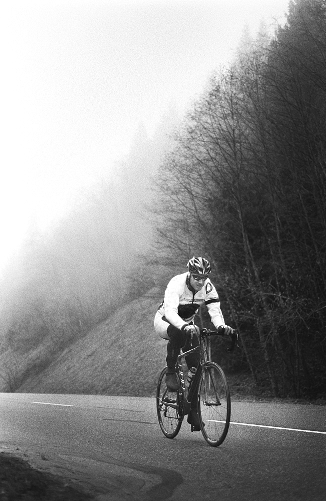 A man on a racing bicycle cycling up a mountain road