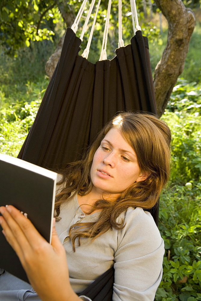 Girl reading in hammock