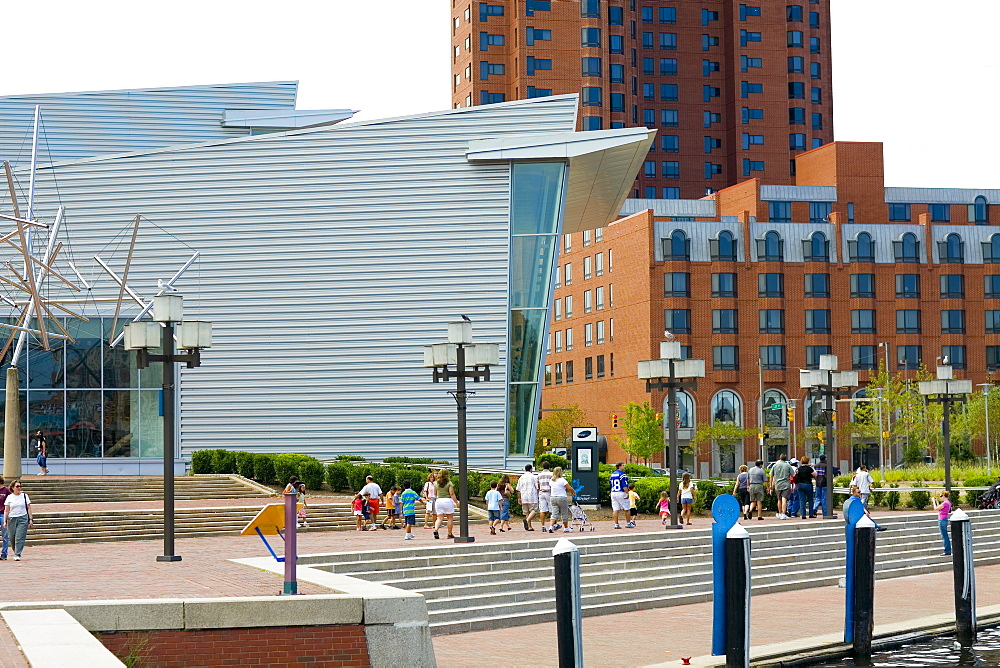 Tourists walking in front of a building, Maryland Science Center, Baltimore, Maryland, USA