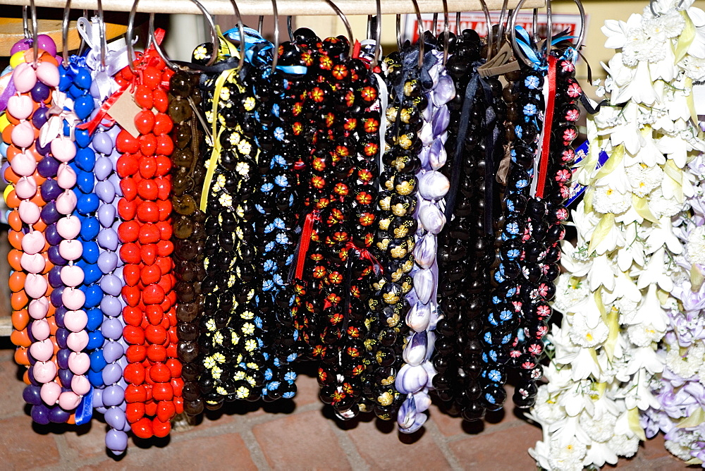 Close-up of garlands and necklaces hanging in a store