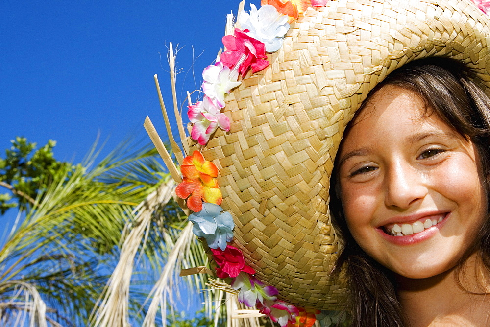 Portrait of a girl wearing a straw hat and smiling
