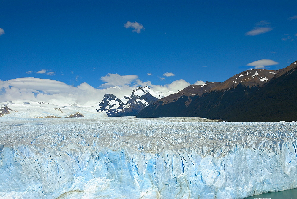 Glacier in a lake with mountains in the background, Moreno Glacier, Argentine Glaciers National Park, Lake Argentino, El Calafate, Patagonia, Argentina