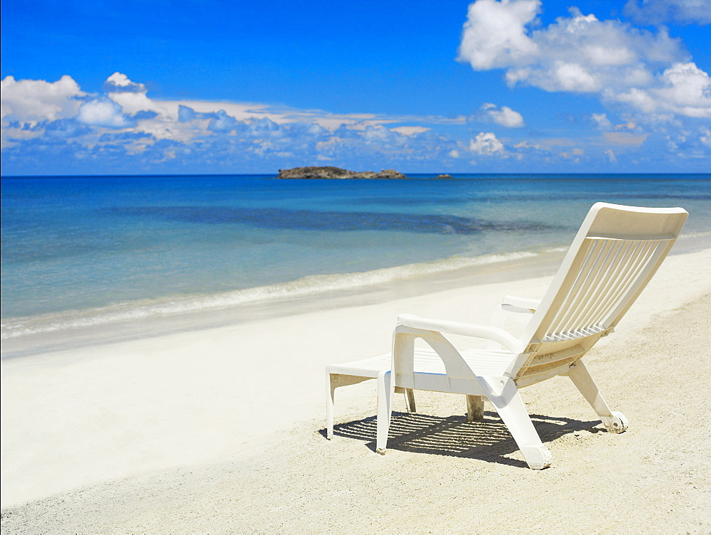 Empty lounge chair on the beach, South West Bay, Providencia, Providencia y Santa Catalina, San Andres y Providencia Department, Colombia