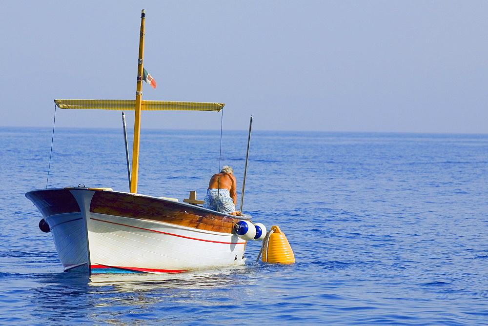Rear view of a man in a boat, Capri, Campania, Italy