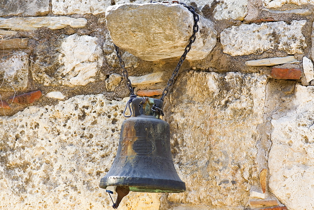 Close-up of a bell hanging on a rock, Athens, Greece