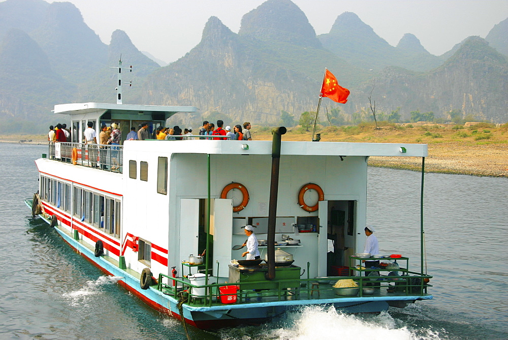 Tourists on a tourboat, Li River, Guilin, China