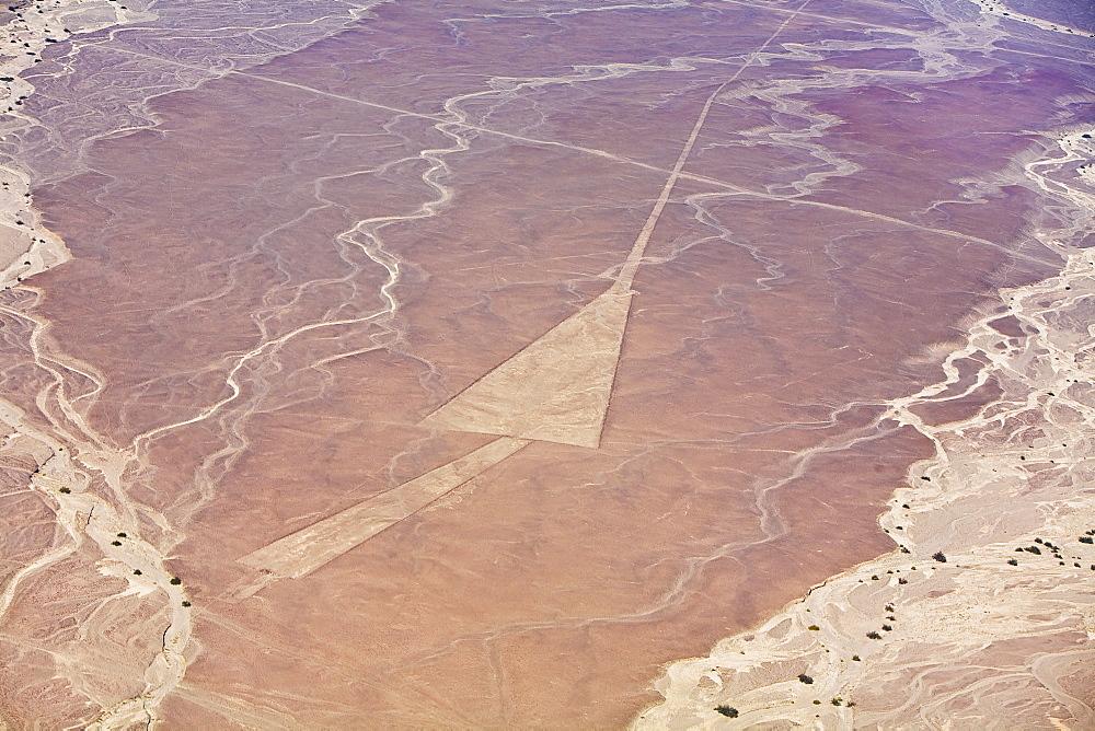 Aerial view of nazca lines representing a triangle in a desert, Nazca, Peru