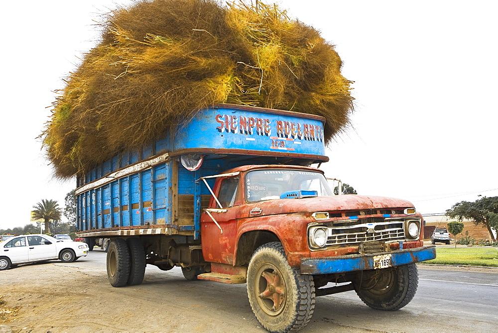 Hay loaded in a truck, Ica, Ica Region, Peru