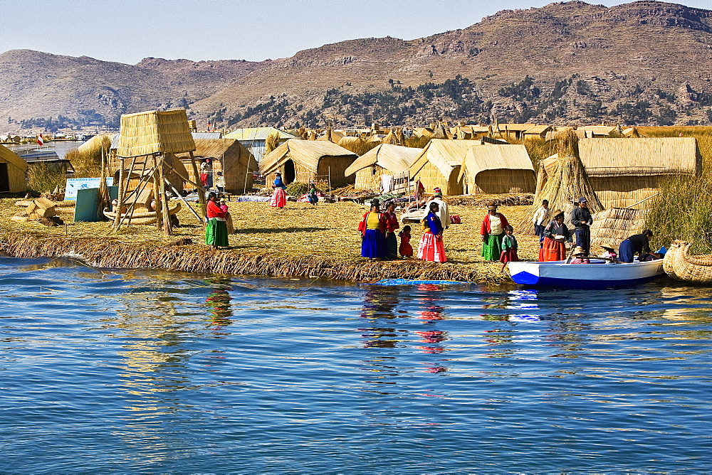 Group of people in a village, Lake Titicaca, Uros Floating Islands, Puno, Peru
