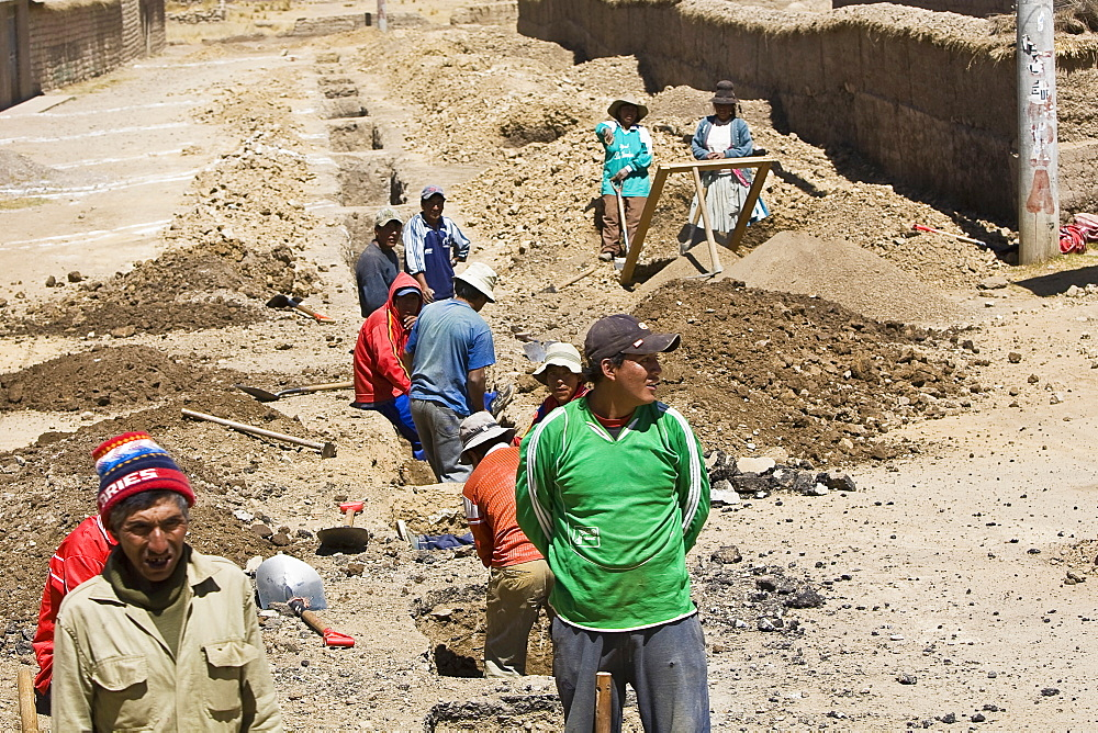 High angle view of a group of people digging a road, Puno, Cuzco, Peru