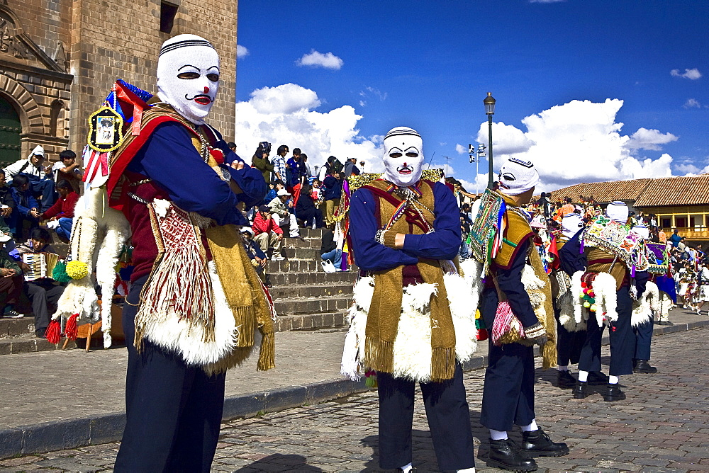 Group of people wearing traditional costume in a festival, Peru