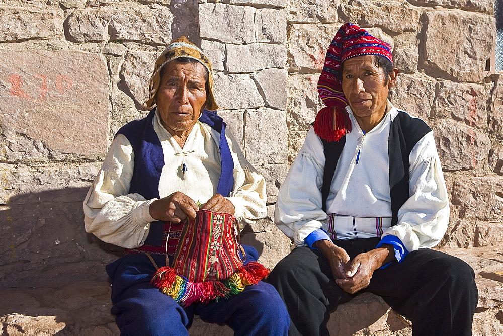 Portrait of two senior men sitting together, Taquile Island, Lake Titicaca, Puno, Peru