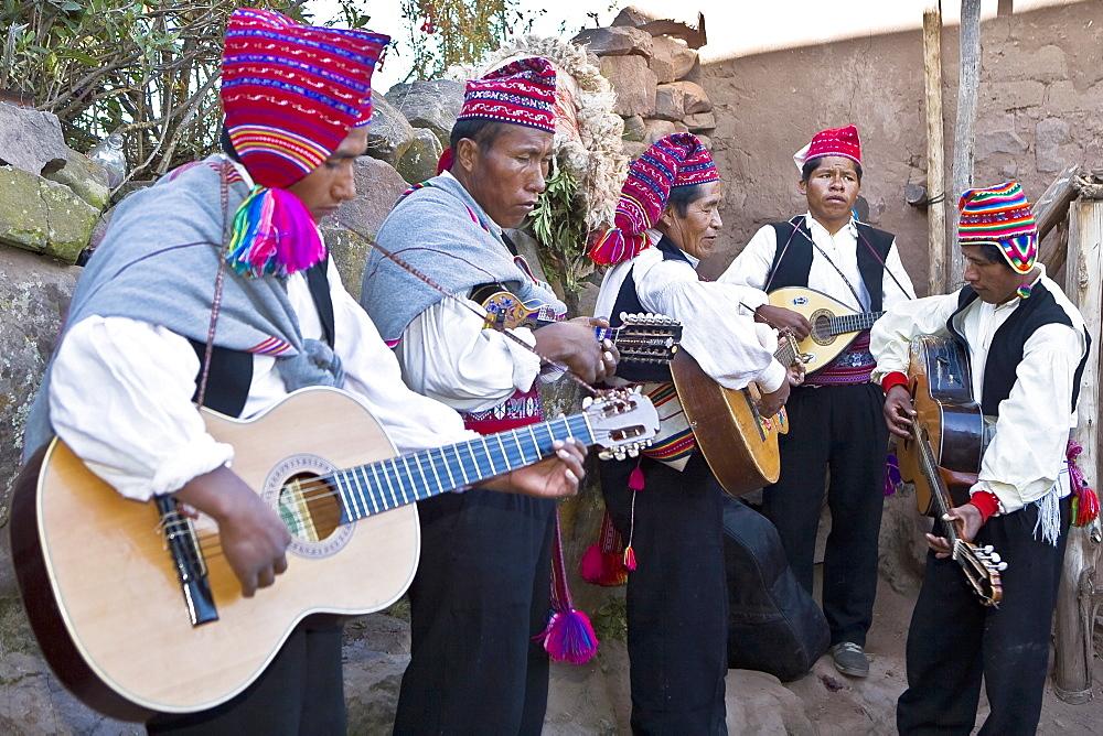 Five guitarists performing, Lake Titicaca, Taquile Island, Puno, Peru