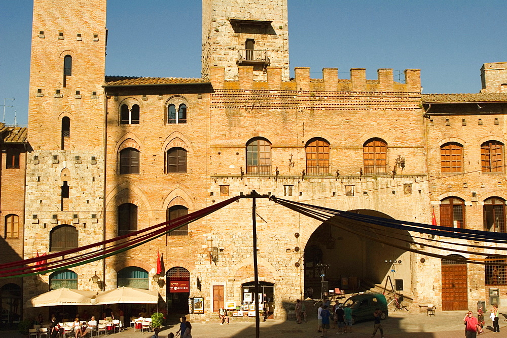 Sidewalk cafe in front of a building, Piazza Duomo, San Gimignano, Siena Province, Tuscany, Italy