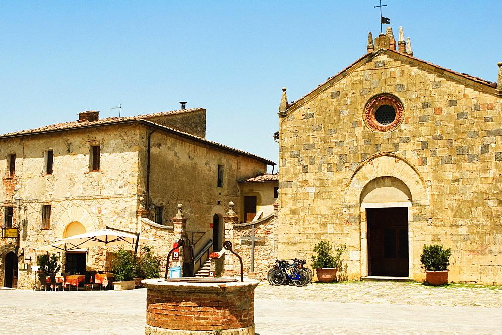Facade of a church, Romanesque Church, Piazza Roma, Monteriggioni, Siena Province, Tuscany, Italy