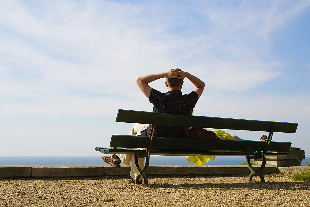 Couple resting on a bench, St. Martin, Biarritz, France