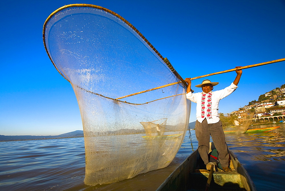 Fisherman with butterfly fishing net in a lake, Janitzio Island, Lake Patzcuaro, Patzcuaro, Michoacan State, Mexico - 788-16401
