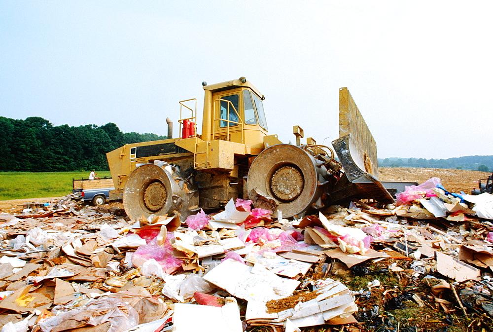 Bulldozer at garbage dump, Howard, Maryland, USA