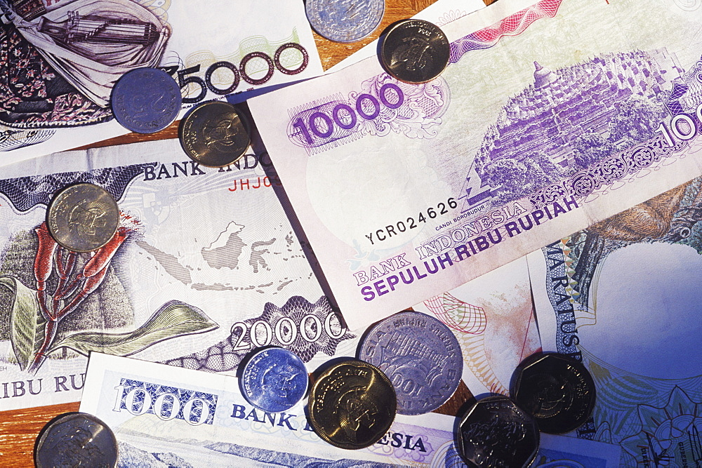 Close-up of Euro cent coins on Euro banknotes
