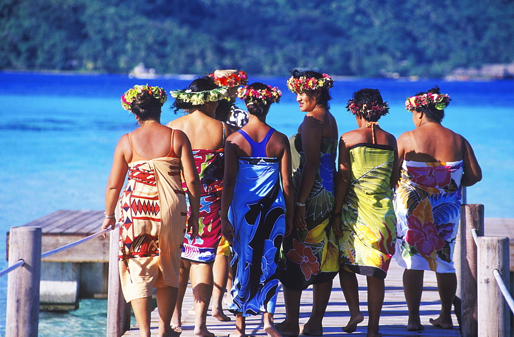 Rear view of a group of mature women walking on a boardwalk, Hawaii, USA