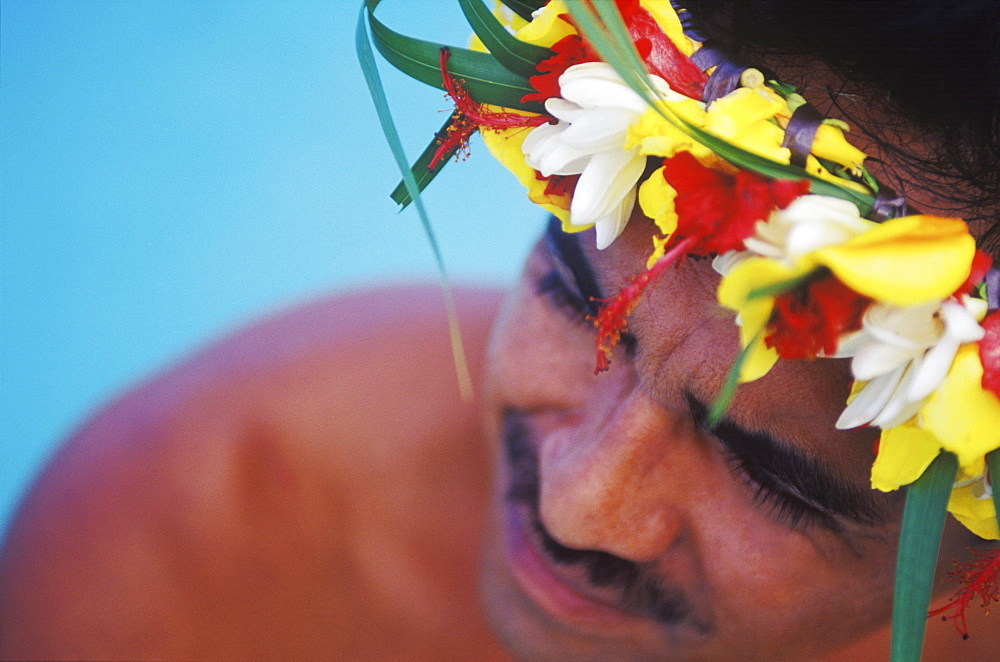 High angle view of a young man wearing a laurel wreath, Hawaii, USA