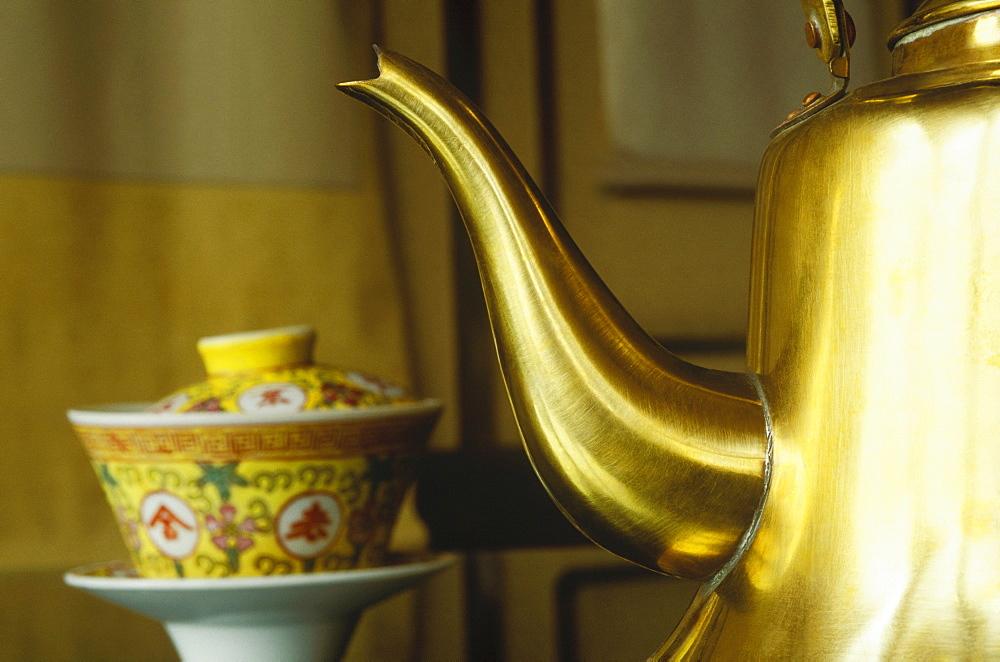 Close-up of a golden teapot