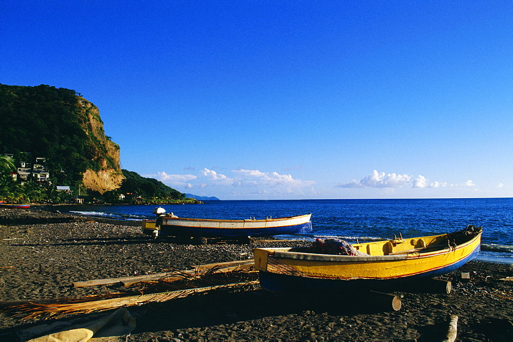 Fishing boats lined up on a seashore, Martinique