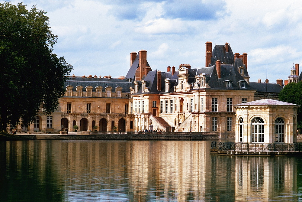 View to Fountainbleau chateau on a riverbank, France