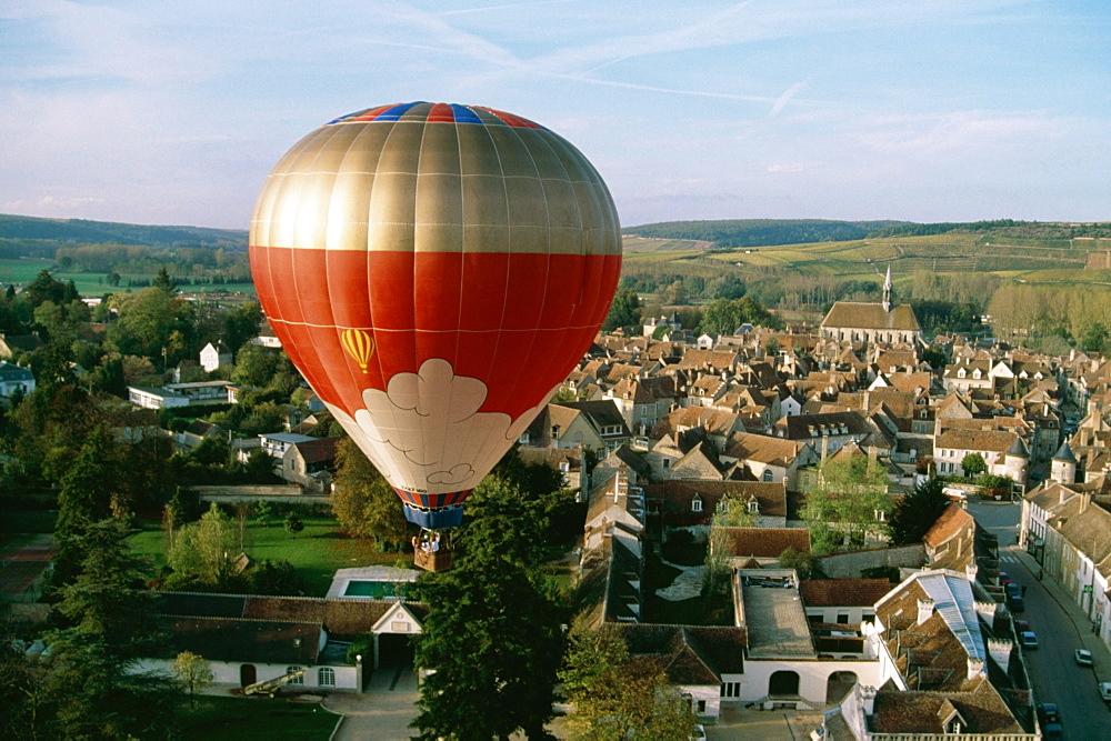 Hot-air-balloon over vineyards, France