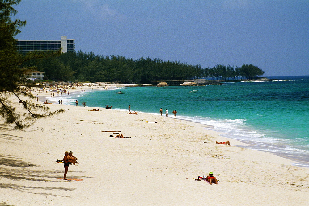 Large group of people sunbathing along the seacoast, Paradise Island, Bahamas