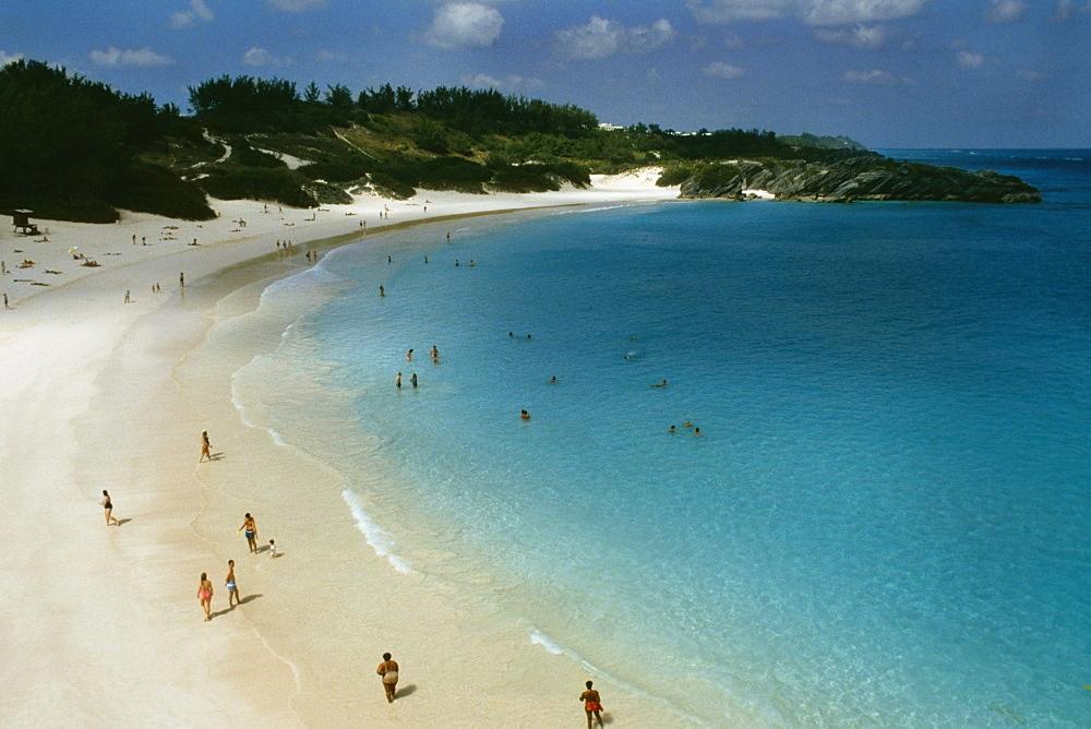 Large group of people holidaying on Horseshoe bay beach, Bermuda