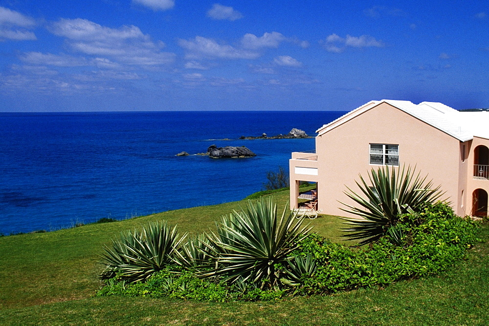 Side view of a pink building facing the ocean, Devonshire north shore, Bermuda