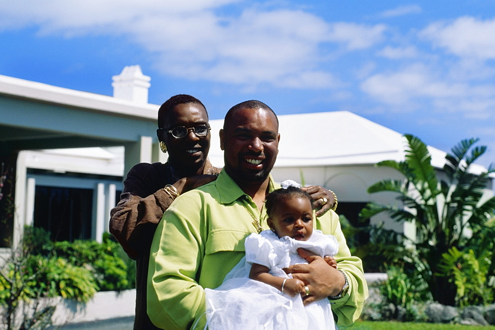 Front view of a couple holding their baby girl, Bermuda