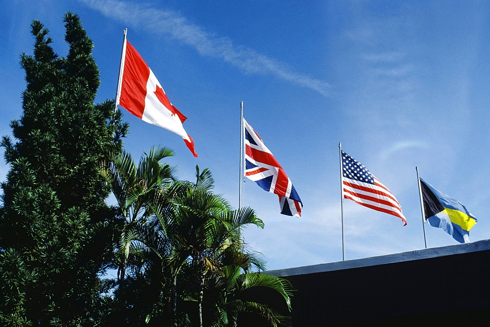 Flags fluttering due to wind on a sunny day, Freeport, Bahamas