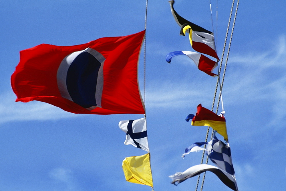 Low angle view of colorful flags against the sky on a sunny day, Crystal palace hotel, Nassau, Bahamas