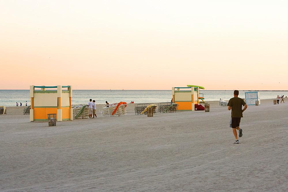 Tourists on the beach at dusk