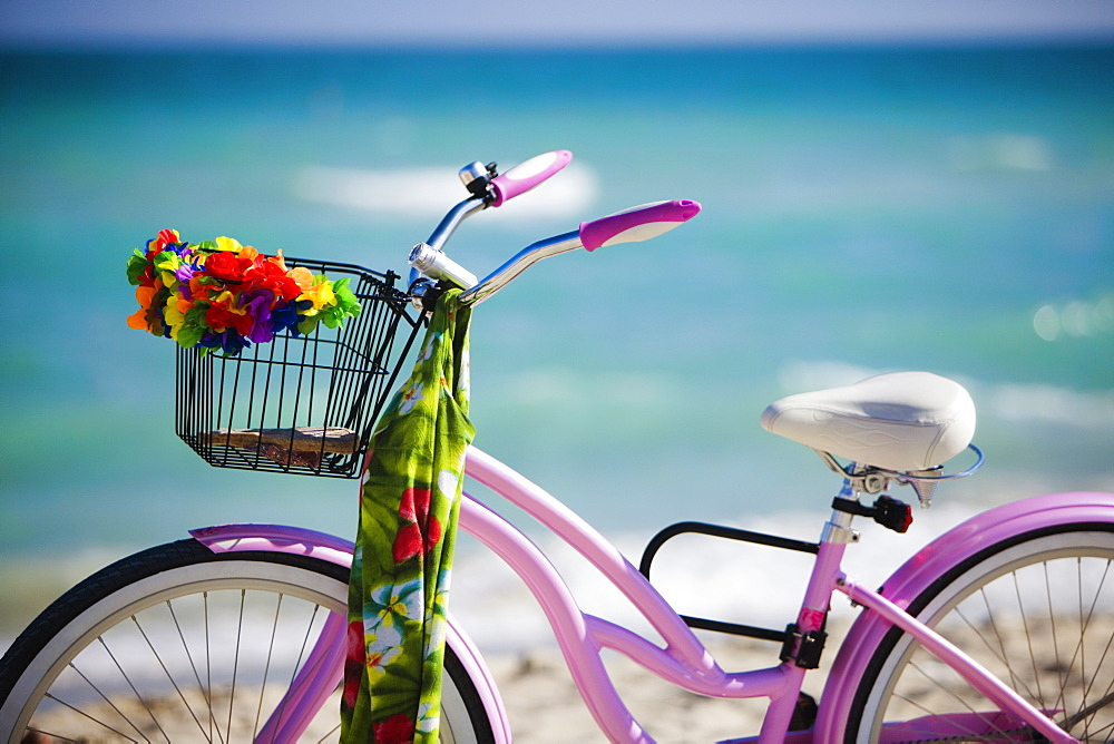 Close-up of a bicycle on the beach