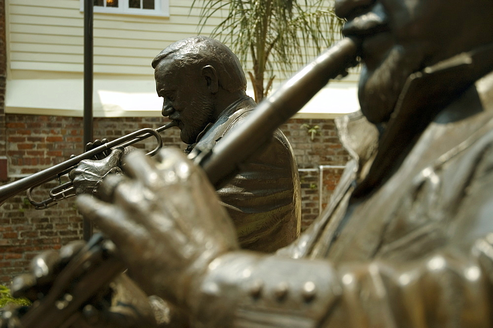 Close-up of statues of two musicians playing musical instruments, New Orleans, Louisiana, USA