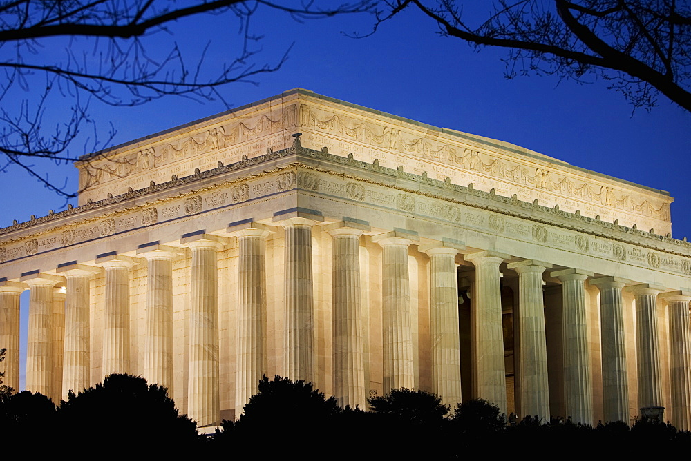 Low angle view of a memorial building lit up at dusk, Lincoln Memorial, Washington DC, USA