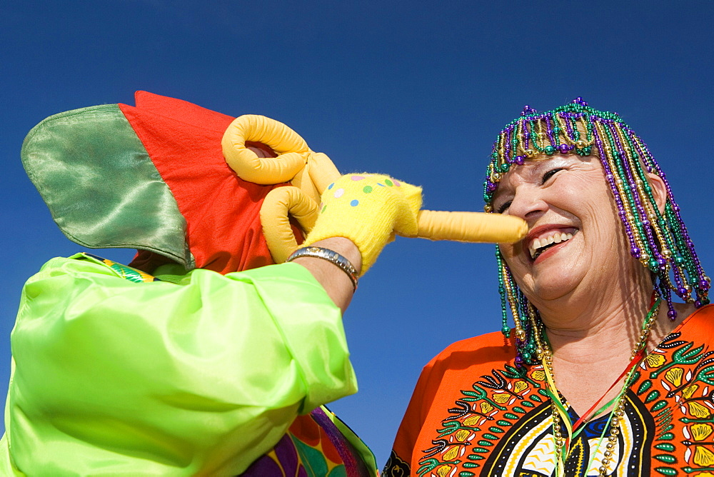 Low angle view of a senior woman wearing beaded headdress and looking at an another woman