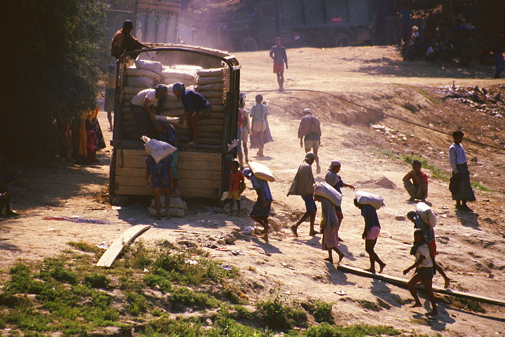 High angle view of manual workers loading a truck, Sagaing, Myanmar