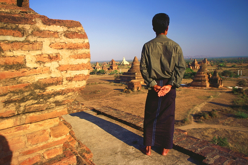 Rear view of a man looking at pagodas, Bagan, Myanmar