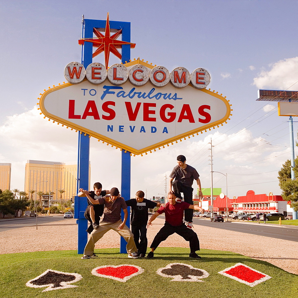 Five teenage boys posing in front of a Las Vegas sign board, Las Vegas, Nevada, USA