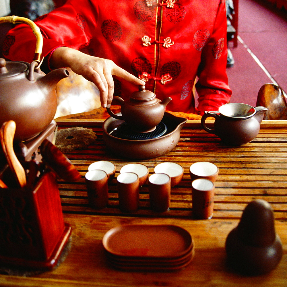Mid section view of a woman preparing tea, Tongli, Jiangsu Province, China