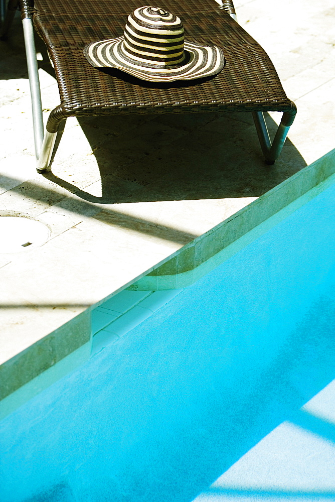High angle view of a lounge chair at the poolside