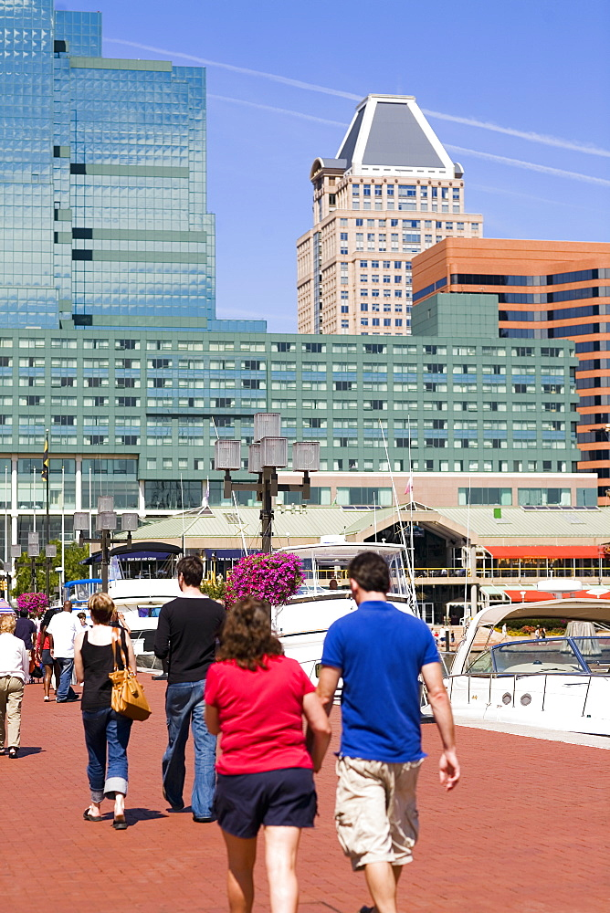 Group of people walking on a pedestrian walkway, Inner Harbor, Baltimore, Maryland, USA