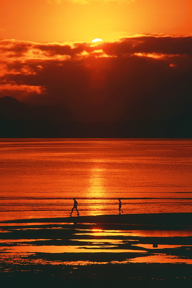 Silhouette of two people on the beach, Suva, Fiji