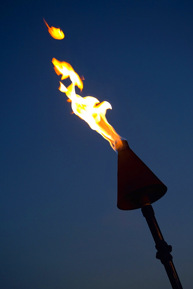 Close-up of a burning flaming torch