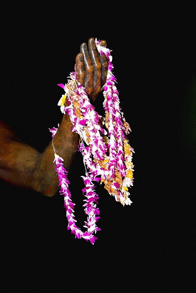 Close-up of garlands on a statue, Duke Kahanamoku Statue, Waikiki Beach, Honolulu, Oahu, Hawaii Islands, USA